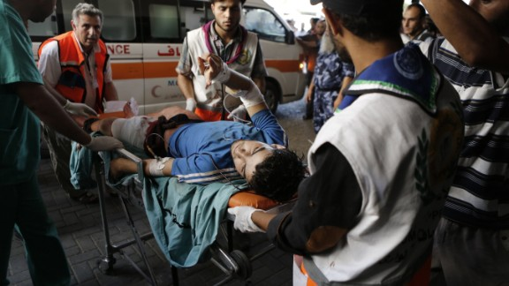 A Palestinian wounded in an Israeli strike on a compound housing a UN school in Beit Hanoun, in the northern Gaza Strip.