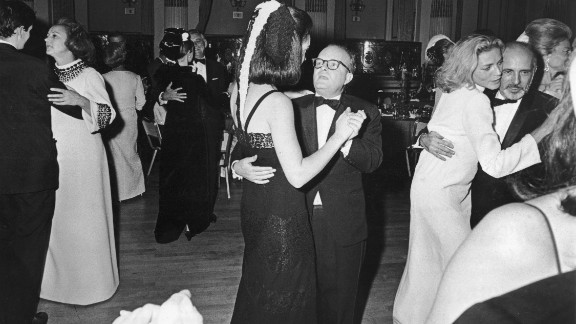 Bacall, right, dances with American dancer and choreographer Jerome Robbins at Truman Capote's (center) 1966 Black and White Ball. Guest of honor Katherine Graham, left, dances with an unidentified man.