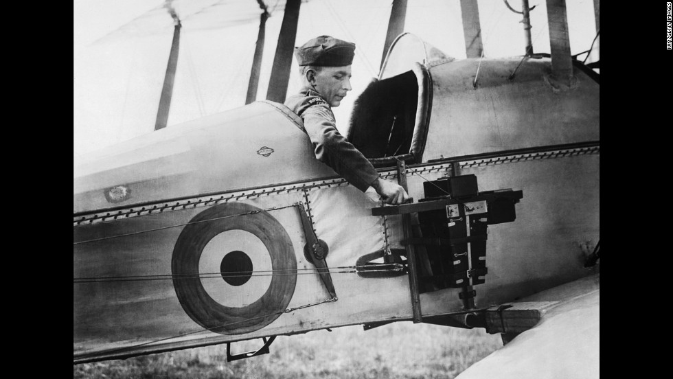 A sergeant of the Royal Flying Corps demonstrates a C type aerial reconnaissance camera fixed to the fuselage of a BE2c aircraft, 1916. For the British, during the war and later for colonial policing in the postwar Middle East, surveillance aircraft seemed to promise vision beyond the mirages, sandstorms, and distances that made the region unmappable in their estimation.