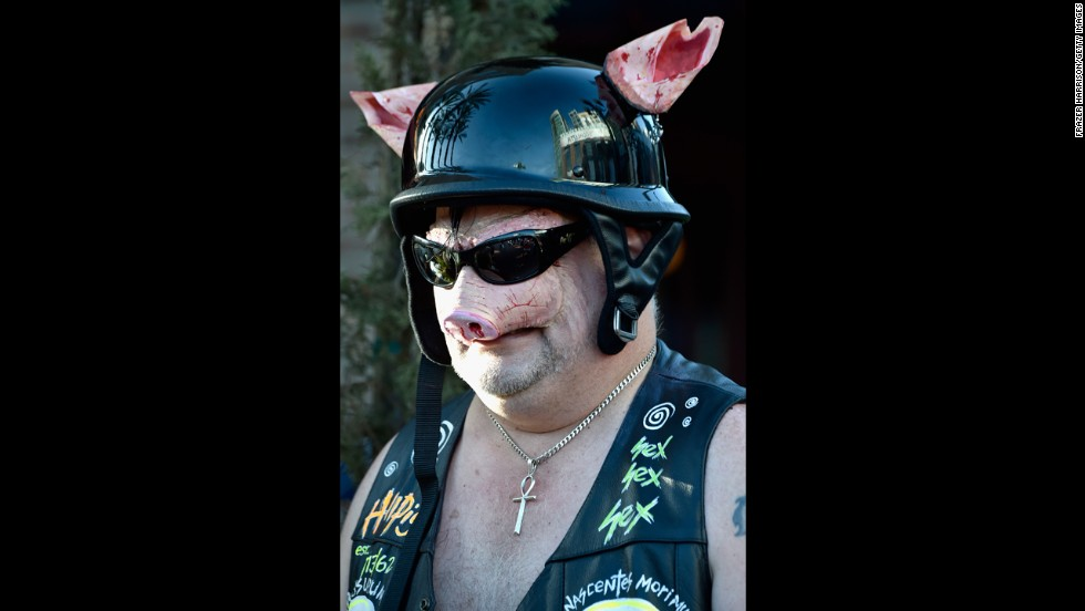 A man dresses as a biker pig on July 24.