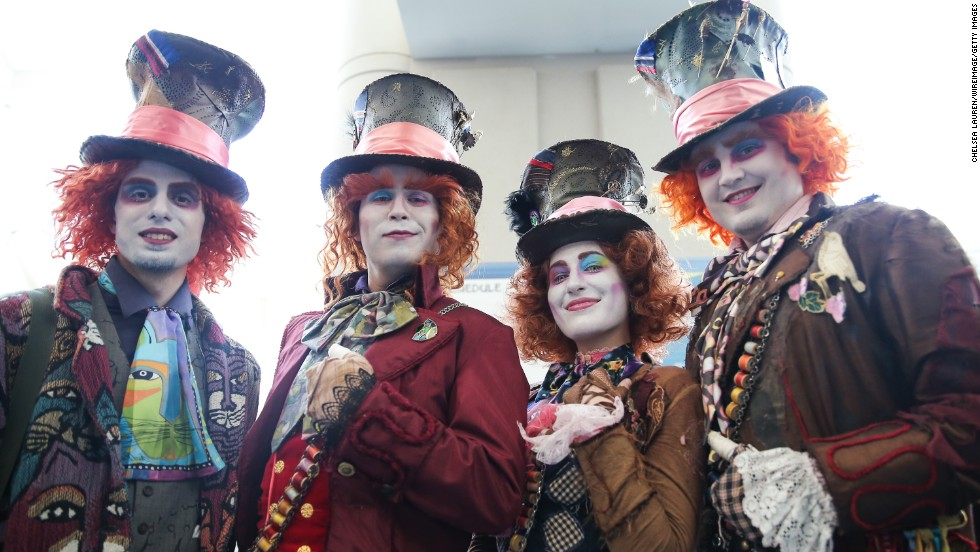 Costumed Mad Hatter fans on July 24.