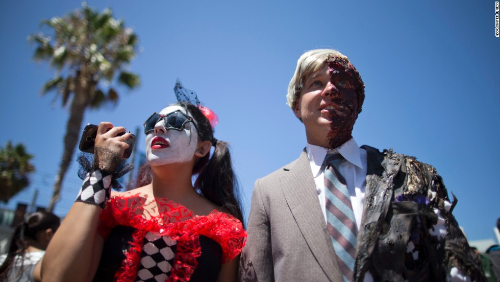 Christine and Justin Skolek walk outside on July 24. Thousands of fans with four-day passes to the sold-out pop-culture spectacular flocked to the event Thursday, many clad in costumes.