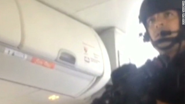 Watch armed police storm plane