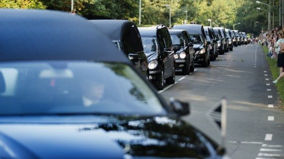 A line of hearses arrives at the Korporaal van Oudheusdenkazerne in Hilversum, Netherlands, on Saturday, July 26, as bodies from the crash of Malaysia Flight 17 are brought to the Netherlands where they will be identified. Flight 17 was shot down over Ukraine, killing all 298 people aboard. Of the people who died, 193 were Dutch citizens.