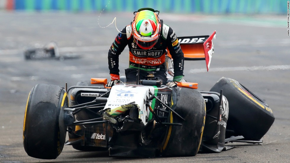 Formula One driver Sergio Perez gets out of his car after crashing during the Hungarian Grand Prix held Sunday, July 27, in Budapest, Hungary.