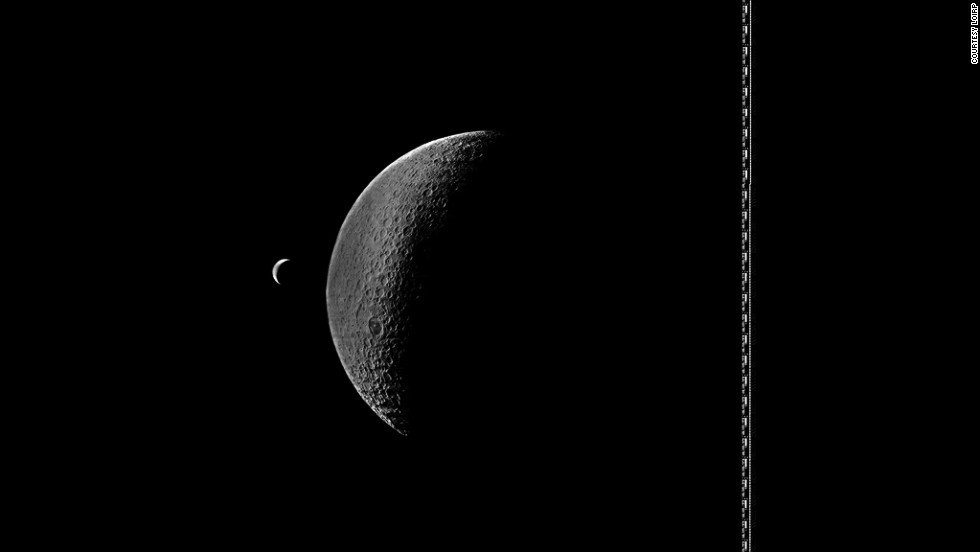 Lunar Orbiter 4 photograph showing a crescent Earth and partly illuminated Moon.