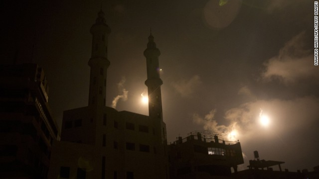 Israeli forces' flares light up the night sky of Gaza City on early on July 29, 2014. Bloodshed in and around Gaza surged Monday with a strike killing eight Palestinian children and a mortar shell leaving four dead  in Israel, shattering hopes for an end to three weeks of devastating violence.