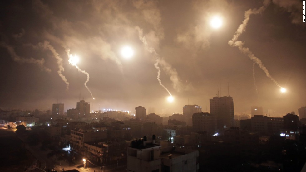 Flares from Israeli forces light up the night sky of Gaza City on July 29.