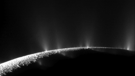 Plumes of water ice and vapor shoot up from the surface of Saturn