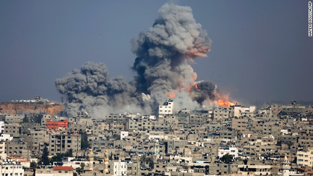 Smoke and fire rise above Gaza City after an Israeli air strike on July 29.
