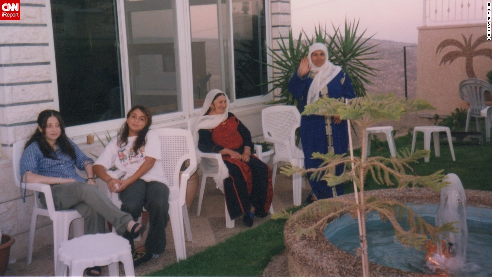 Naim Naif's grandmother, sister and cousin sit outside on the patio of the family's Palestinian home in 2000.
