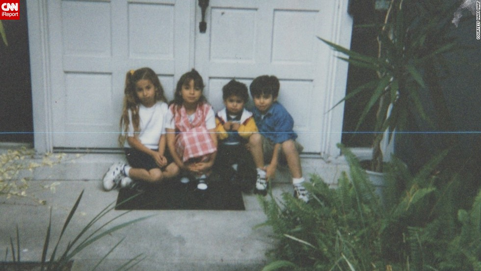 The Naif siblings sit outside the family's home in Tampa. From left to right, Atheer, Athar, Naim (the author) and Nayef.