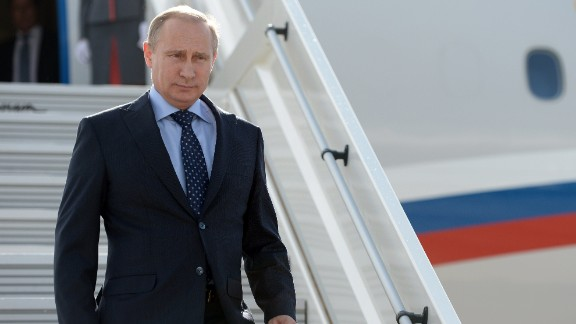 "Russia's President Vladimir descends from his plane while arriving in the Volga River city of Samara 868 km (539 miles) southeast of Moscow, on July 21, 2014. US President Barack Obama said yesterday that Putin must prove ""that he supports a full and fair investigation"" of the Malaysian plane disaster. AFP PHOTO / RIA-NOVOSTI / POOL/ ALEXEI NIKOLSKYALEXEI NIKOLSKY/AFP/Getty Images"