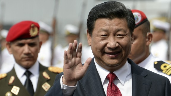 Chinese President Xi Jinping waves upon arrival in Caracas on July 20, 2014. Xi departed Argentina Sunday for Venezuela, the next-to-last stop of a Latin American tour aimed at bolstering trade with the region. AFP PHOTO/LEO RAMIREZLEO RAMIREZ/AFP/Getty Images