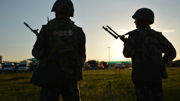 Anti-terrorism forces stand watch in this file image taken in northwest China's Xinjiang region.