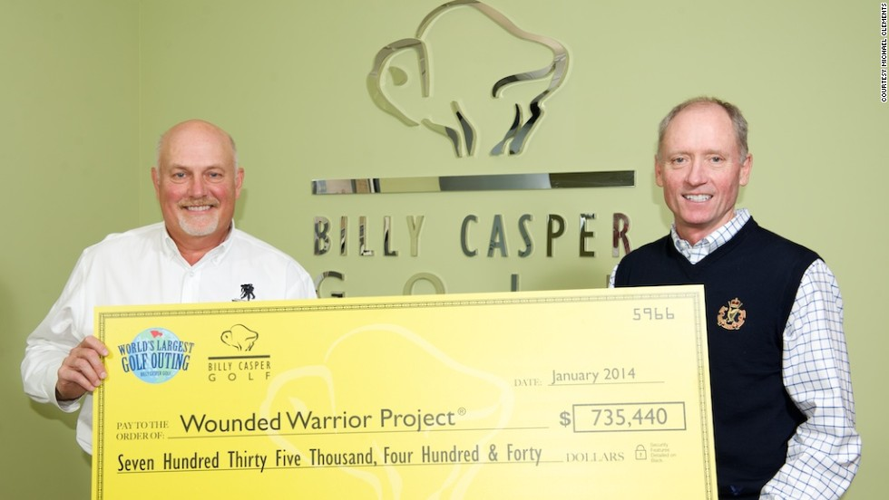 Peter Hill, CEO of Billy Casper Golf, presents a check to the Wounded Warrior Project for funds raised by the WLGO, which this year takes place at over 150 U.S. courses.