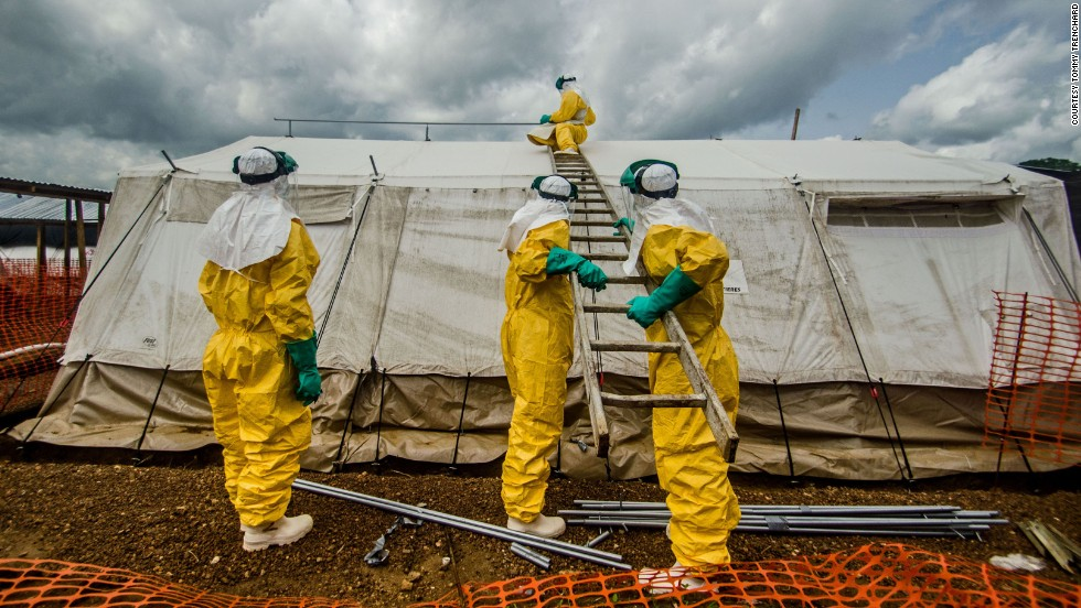 Members of Doctors Without Borders adjust tents in the isolation area in Kailahun on July 20, 2014.