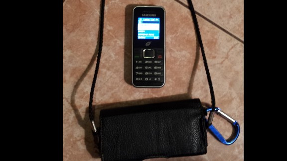 The cell phone and holder that Dominic carries at his mom