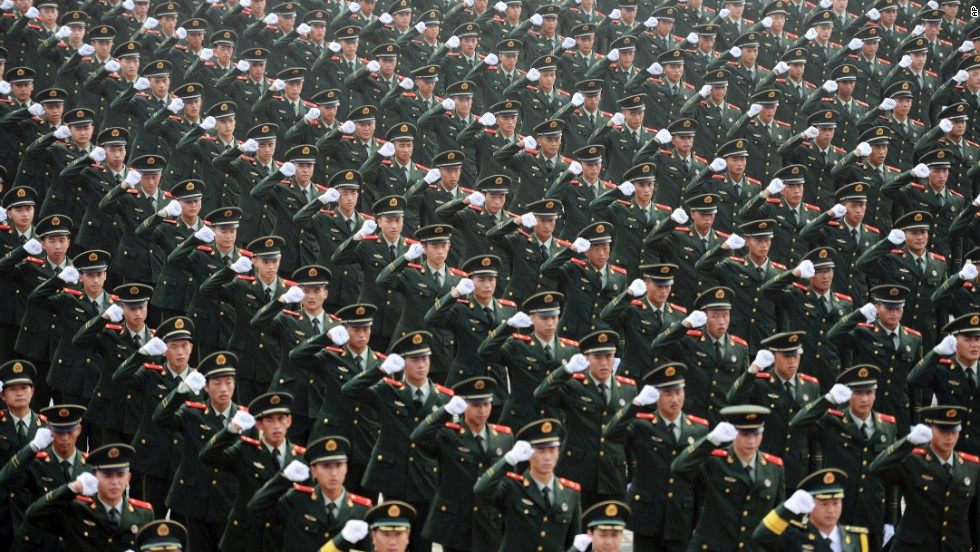 Chinese paramilitary police officers take a pledge to ensure security during the upcoming Youth Olympic Games in Nanjing, China, on Tuesday, July 29.