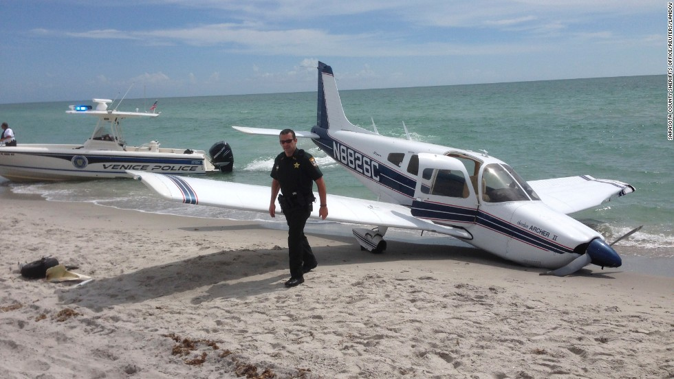 "First responders work the scene of a <a href=""http://www.cnn.com/2014/07/29/us/florida-plane-accident/index.html"">single engine Piper Cherokee plane crash</a> at Caspersen Beach in Venice, Florida, on Sunday, July 27. A 9-year-old girl and her father were struck by the plane walking along a Florida beach. The father died at the scene, and the girl succumbed to her injuries on Tuesday, July 29."