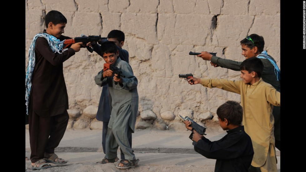 "Children play with plastic guns as they celebrate Eid al-Fitr and the end of the fasting month of <a href=""http://religion.blogs.cnn.com/2014/06/28/the-belief-blog-guide-to-ramadan/"" target=""_blank"">Ramadan</a> in Jalalabad, Afghanistan, on Tuesday, July 29."
