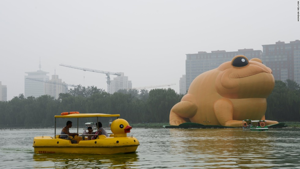 "Tourists ride boats to snap a closer picture. ""Toad"" is among the top censored words on Weibo."