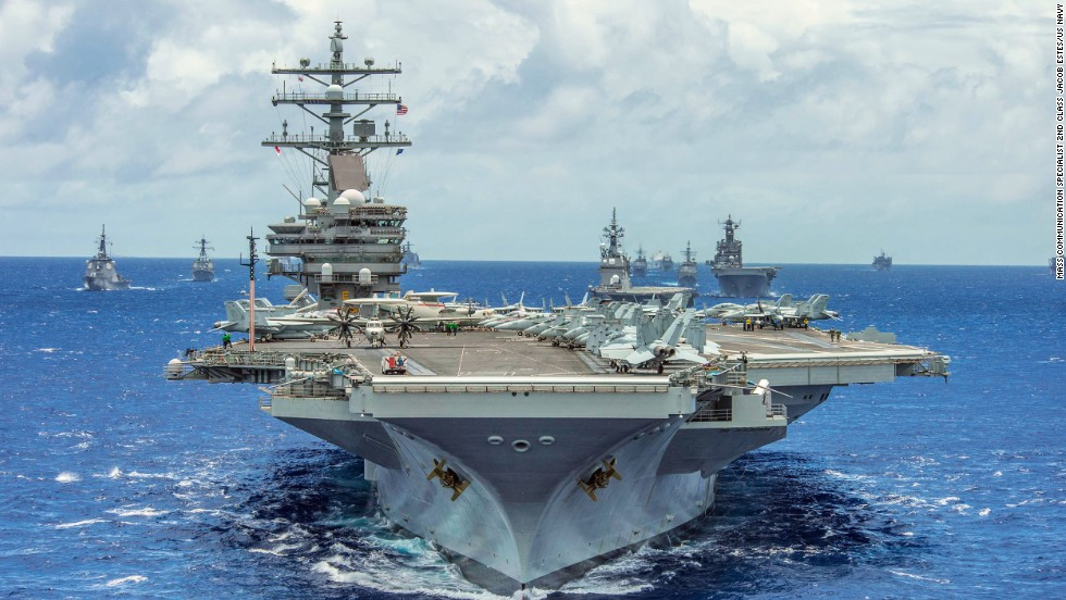 The aircraft carrier USS Ronald Reagan leads a formation of 42 ships and submarines from 15 international partner nations during Rim of the Pacific (RIMPAC) 2014.