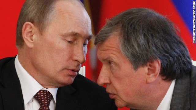 Russia's President Vladimir Putin talks to Rosneft President Igor Sechin in Moscow in 2013.