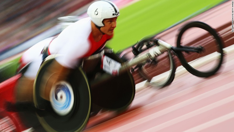 AUGUST 1 - GLASGOW, SCOTLAND: David Weir of England competes in the Glasgow 2014 Commonwealth Games. Unlike the Olympics and Paralympics, at the Commonwealth Games events for disabled athletes take place at the same time as the able-bodied competitions.