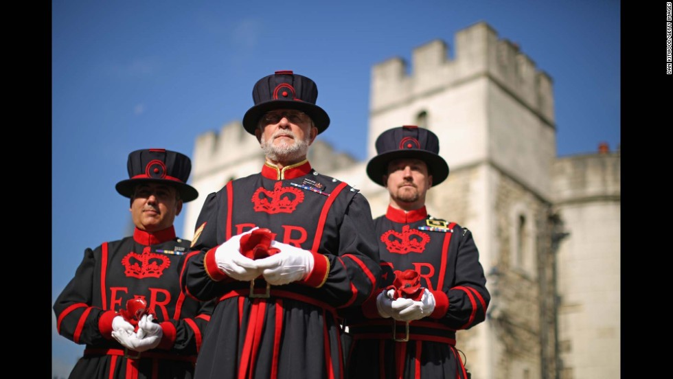 Butler, center, and other Yeoman Warders pose with ceramic poppies on July 17.