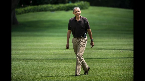 President Barack Obama walking from Marine One upon his return to the White House in August 2012 following a visit to Camp David, Maryland, where he spent his 51st birthday.