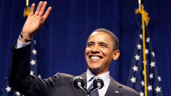 "Democratic presidential candidate Barack Obama smiles and waves as the crowd sings ""Happy Birthday"" to him before his speech at the Lansing Center in Lansing, Michigan, on August 4, 2008."