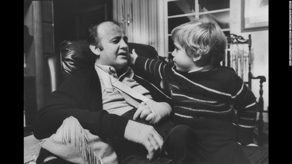 Brady, with his left hand in a sling, chats with his son, Scott, in November 1981. Because of the shooting, Brady had to use a wheelchair for the rest of his life.