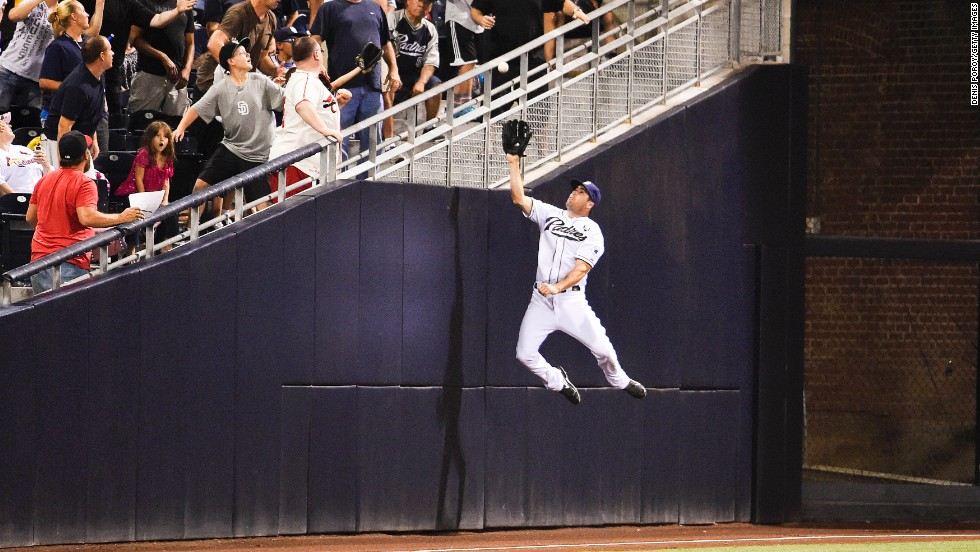 Seth Smith of the San Diego Padres jumps but can't make the catch on a foul ball that was hit by St. Louis' Matt Carpenter during a Major League Baseball game Wednesday, July 30, in San Diego.