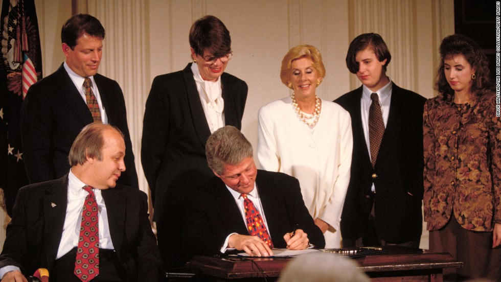 Brady is next to President Bill Clinton as Clinton signs the Brady Bill on November 30, 1993. The bill, which was fiercely fought over for years before Congress approved it, required background checks for gun purchases.