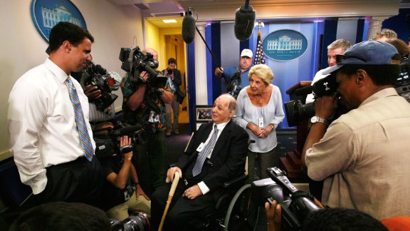 Brady visits the White House Briefing Room with his wife as White House Deputy Press Secretary Bill Burton, left, shows them around in June 2009.