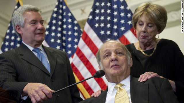 Former White House Press Secretary Jim Brady (C) speaks alongside his wife, Sarah (R), and Brady Campaign President Paul Helmke (L), about new legislation curbing gun violence during a press conference on Capitol Hill in Washington, DC, March 30, 2011. Brady was shot by John Hinkley, Jr, during his attempt to assassinate former US President Ronald Reagan on March 30, 1981. AFP PHOTO / Saul LOEB (Photo credit should read SAUL LOEB/AFP/Getty Images)