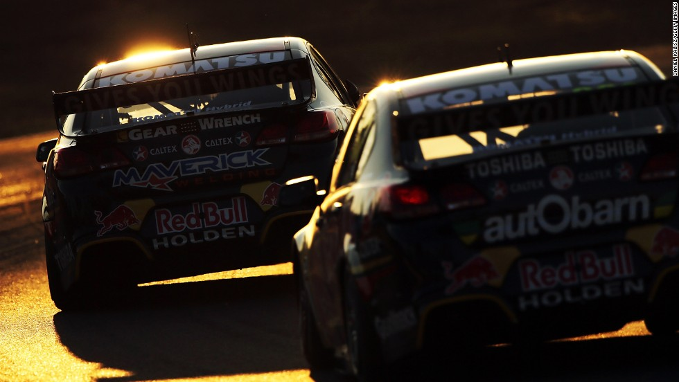 Jamie Whincup leads Craig Lowndes in a race at the Ipswich 400, held Saturday, August 2, at Queensland Raceway in Ipswich, Australia. Whincup won two of the three races at Queensland to move atop the standings of the V8 Supercar Championship Series.