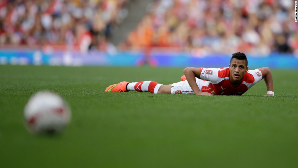 Arsenal's Alexis Sanchez watches the ball during a preseason match played Saturday, August 2, against Portuguese club Benfica in London. It was Sanchez's first match with his new club since his transfer from Spanish club Barcelona.