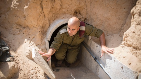 An Israeli soldier in 2014 examines a tunnel built underground by Hamas militants leading from Gaza.