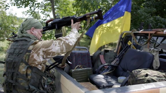 Ukrainian servicemen from the Donbass volunteer battalion on August 4, 2014 prepare for redeployment from Popasna, Lugansk region, freed by Ukrainian forces from the pro-Russian militants, to Donetsk. The deputy mayor in the encircled insurgent stronghold of Donetsk told AFP that shooting in a residential suburb had killed six civilians and injured 13, the latest victims of more than three months of civil war that has claimed at least 1,150 lives. AFP PHOTO/ ANATOLII STEPANOVANATOLII STEPANOV/AFP/Getty Images