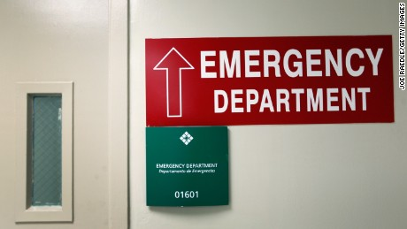 MIAMI, FL - APRIL 30: A sign giving direction to The University of Miami Hospital's Emergency Department hangs on a wall on April 30, 2012 in Miami, Florida. As people wait to hear from the United States Supreme Court on its decision of the constitutionality of the Affordable Care Act, some experts say that if the act is overturned, a decision expected later this year, people that now have insurance will no longer be eligible and will be kicked back into a system where the emergency department is their first visit when sick. (Photo by Joe Raedle/Getty Images)