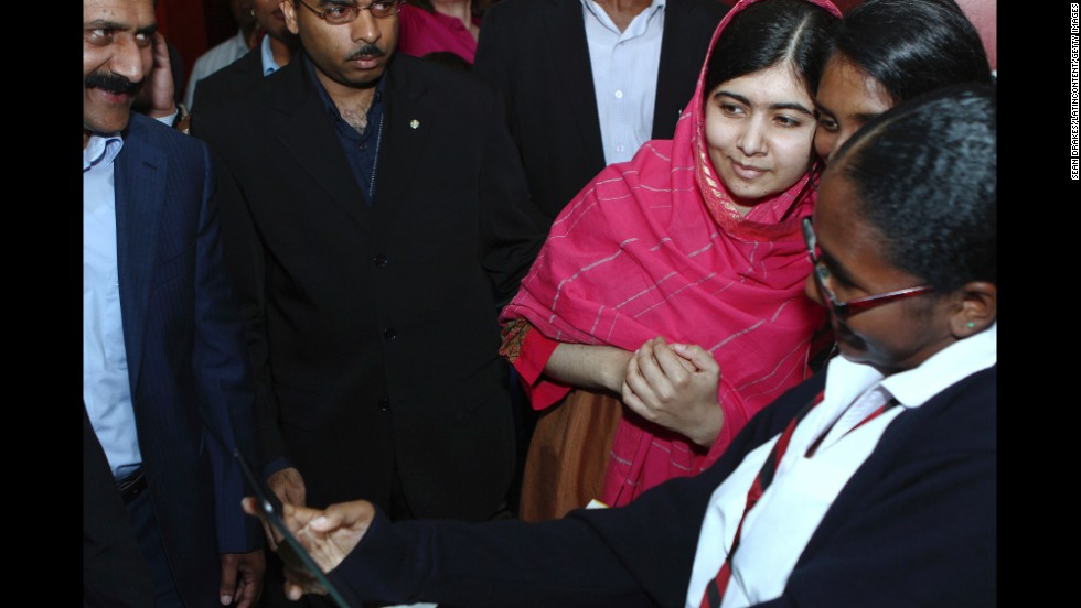 Malala Yousafzai, third from right, poses with admirers Wednesday, July 30, at the National Academy for the Performing Arts in Port of Spain, Trinidad. Malala is the Pakistani schoolgirl who survived a Taliban attack to become a leading activist for the education of girls.