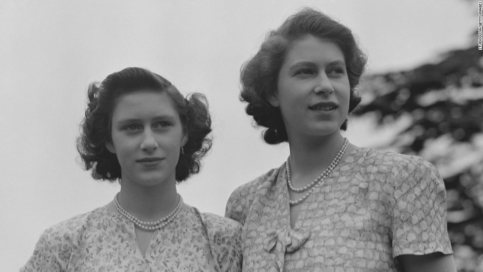 Princess Elizabeth, right, and Princess Margaret wear summer dresses circa 1942. Margaret is Elizabeth's only sibling.