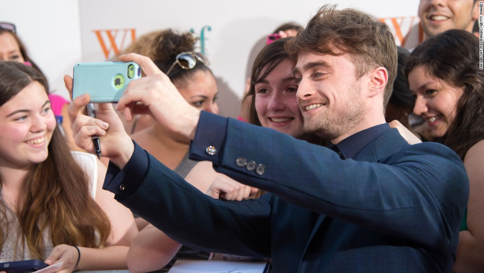 "Actor Daniel Radcliffe takes a selfie with a fan at the New York premiere of the film ""What If"" on Monday, August 4."