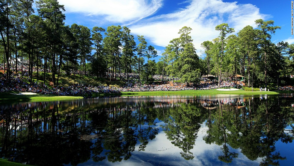 "Cannon describes the par-three competition on the short course at Augusta National as one of the most spectacular events to photograph.<br /><br />""This picture was (the result of) having such a perfect sky on one of the stillest afternoons,"" he says.<br /><br />""I was able to capture the almost perfect 'mirror' effect of the eighth and ninth greens, surrounded by thousands of 'patrons,' as the spectators are known at Augusta."""