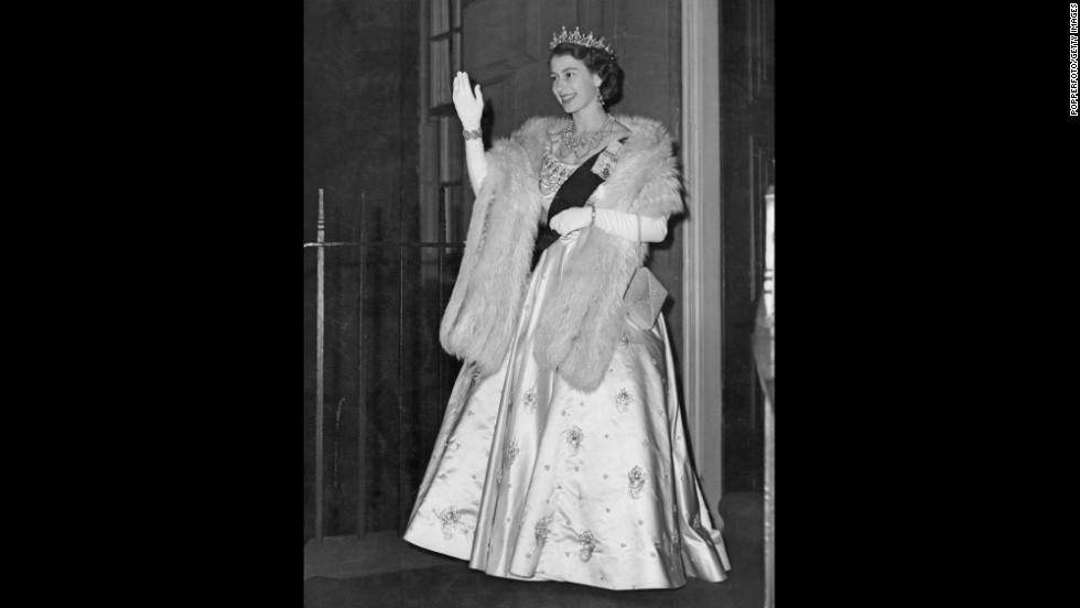 Elizabeth ascended to the throne in February 1952, when her father died of lung cancer. Here, the new Queen leaves the Royal Archers Hall in Edinburgh after a ball in June 1952. It was the first function she attended as Queen following her father's death.