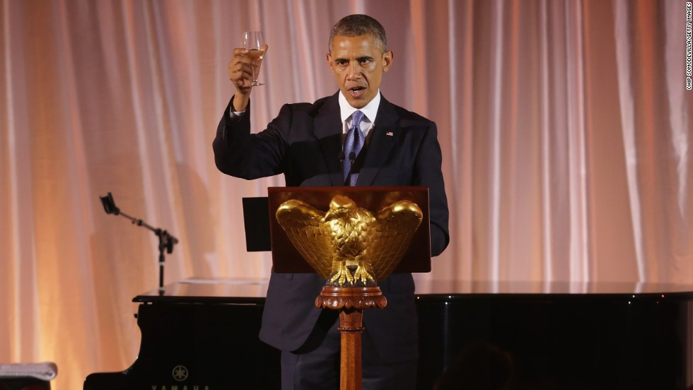 President Barack Obama raises a glass and toasts his guests during a dinner of the U.S.-Africa Leaders Summit on the South Lawn of the White House on Tuesday, August 5, in Washington. Obama is promoting business relationships between the United States and African countries during the three-day summit, where heads of state are meeting.