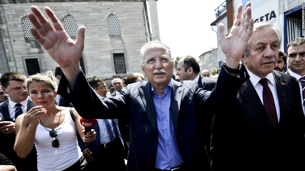 Ihsanoglu greets supporters during an event in Istanbul on Wednesday, July 23.