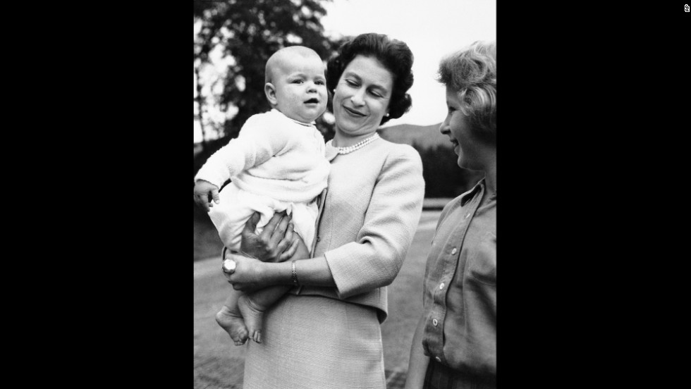 The Queen holds her son Andrew while his sister, Anne, watches during a family holiday at Scotland's Balmoral Castle in September 1960.